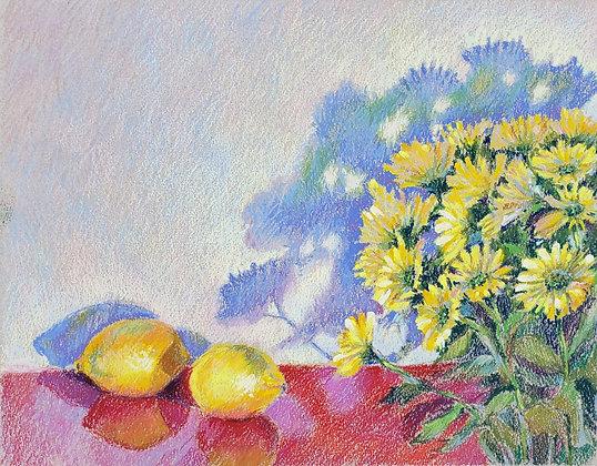 Yellow chrysanthemums and lemons