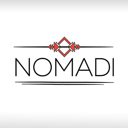 white small nomadi logo.png