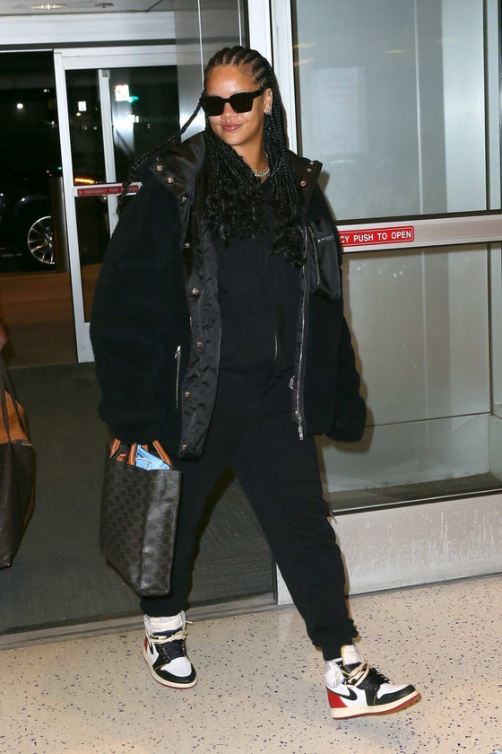 Rihanna Arrives At JFK Airport In Trendy Casual Outfit