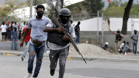 Haiti's Police And Army Troops Exchange Fire