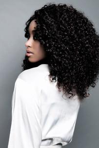 Wild flirty curls with an intense smouldering eye