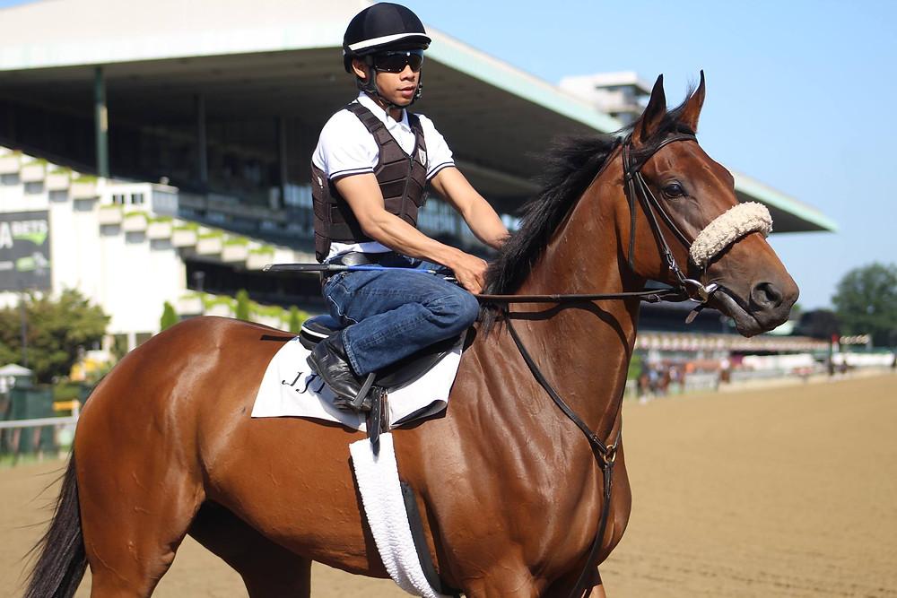 Violet Blue with Belmont Oaks jockey Manny Franco just before her last breeze at Belmont.