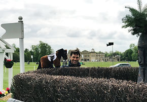 Great British Equestrian Harry Meade stands in front of Badminton House at the horse trials