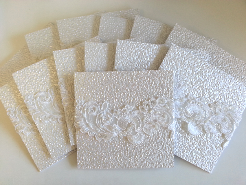 Embossed white lace wedding invitation sydney Australia.jpg