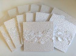 Embossed white lace wedding invitation sydney Australia.jpg