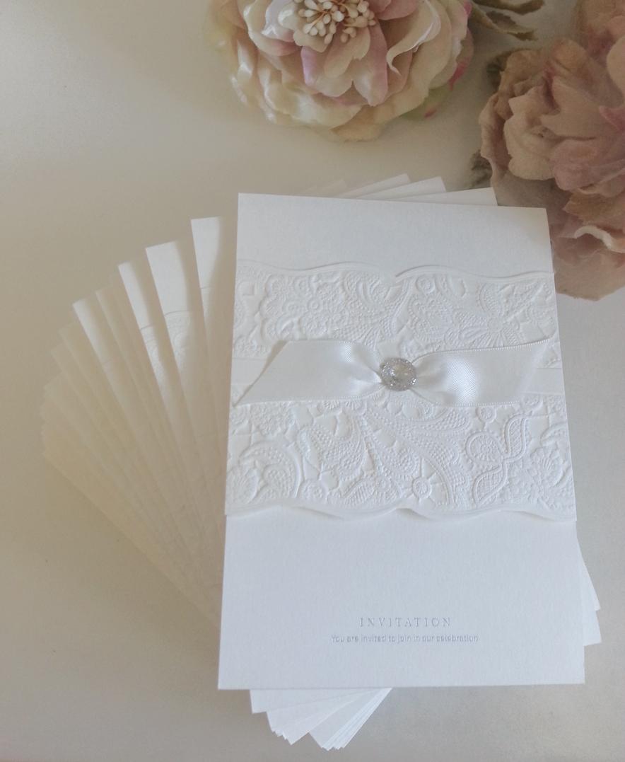 White Embossed diamantes sparkling Wedding invitations sydney.jpg