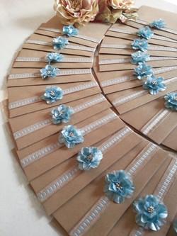 beautiful silk duck blue flower with elegant ribbon wedding invitation.jpg