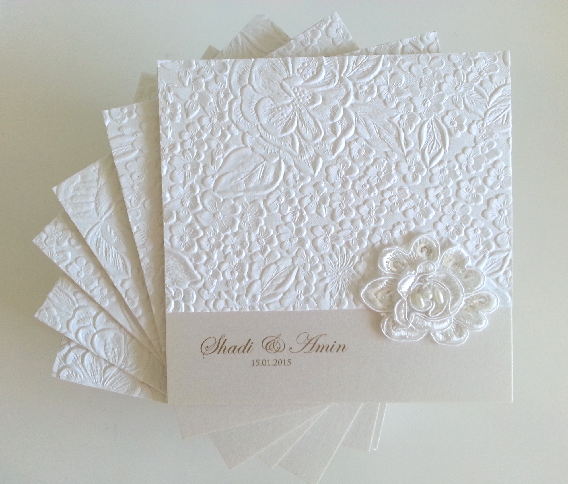 Embossed rose lace folded square wedding invitation sydney.jpg