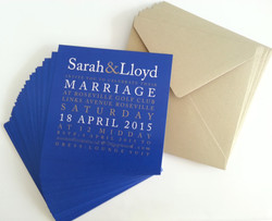 Spread out solid blue printing with antique gold and white text wedding invitati