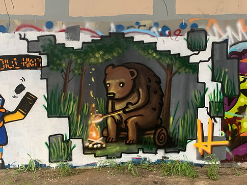 street art of bear roasting marshmellow by josh harnack