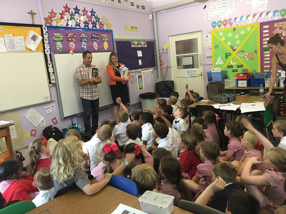 Danny and Carly with a class at St Anthony's Primary School