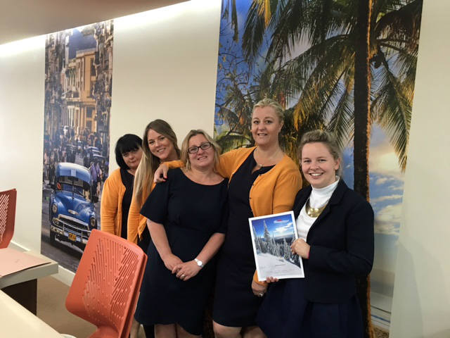 Julie Geyer (far right, holding brochure) with the team.