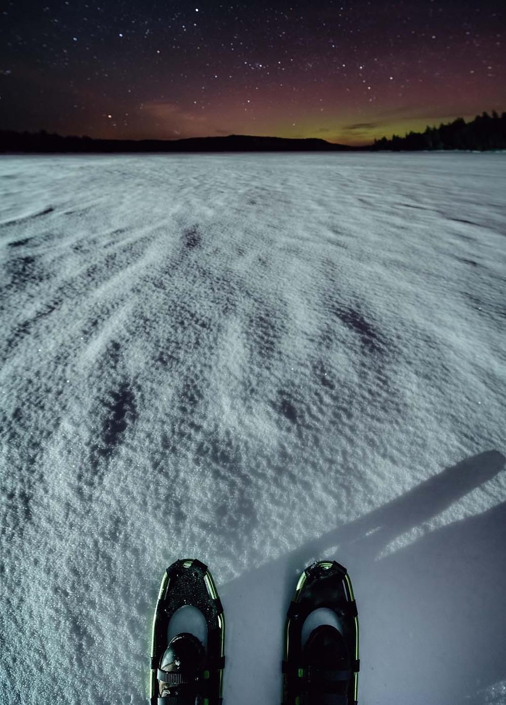 Snowshoe under the northern lights