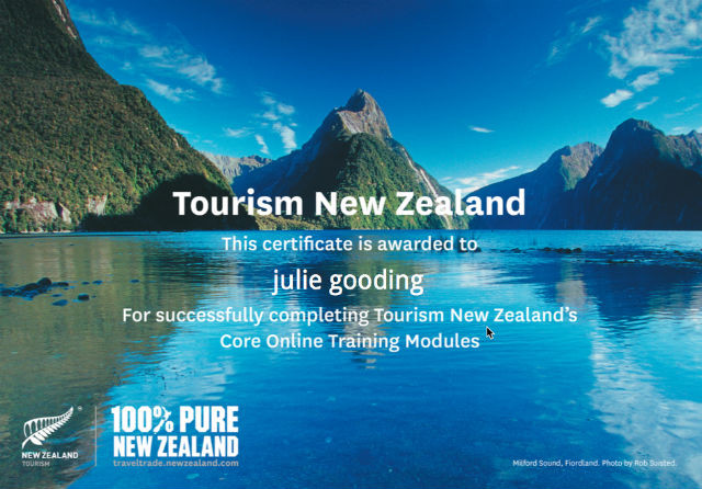 Julie showing off her certificate from Tourism New Zealand