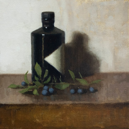 Gin bottle and sloes