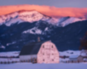 white barn and Bridger Mountains landscape photography by Scott Wheeler