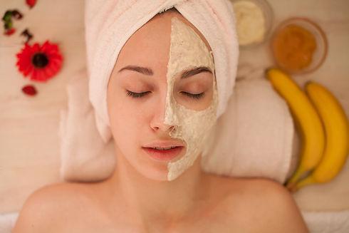 Beautiful Woman With Cosmetic Mask on Fa