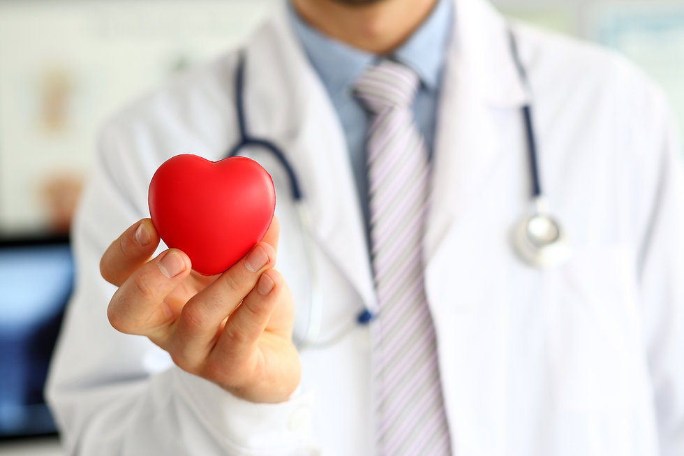 Focus on male hand with red heart-shaped