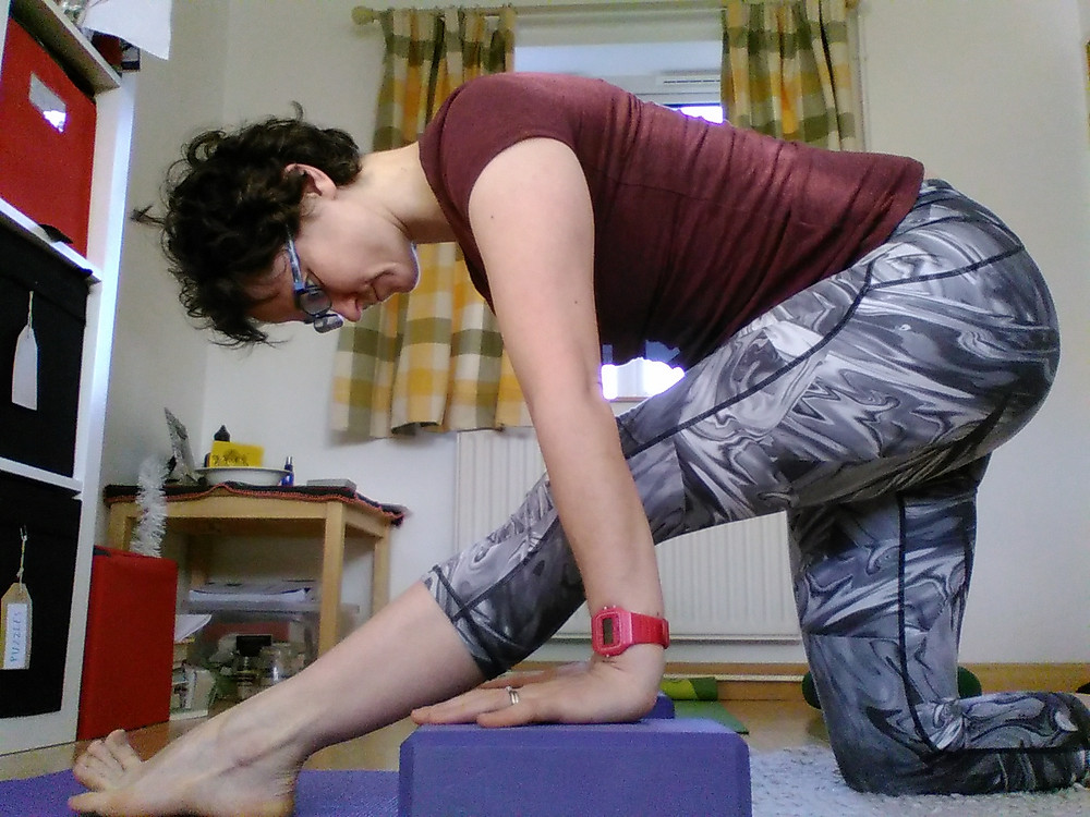 Nomad's pose is great for  exercising self-compassion when stretching the hamstrings.