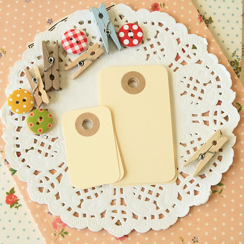 cream rounded rectangle tags