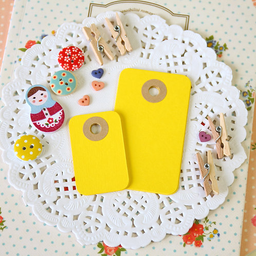 bright yellow rounded rectangle tags