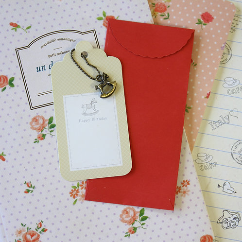 rocking horse charm and scallop gift tag