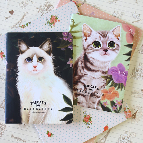 the cat's backgarden cartoon notebook