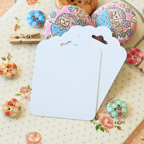 smooth white ornate scallop tags
