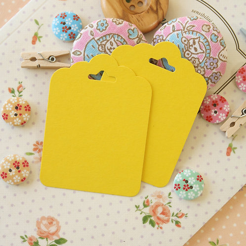 bright yellow ornate scallop tags