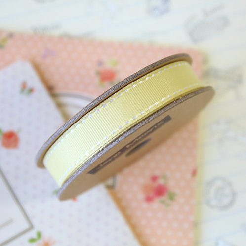 jane means pale yellow stitched grosgrain ribbon