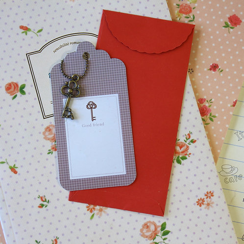 key charm and scallop gift tag