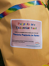 A yellow envelope with a rainbow border shows the Popsicle Puppets in Space label