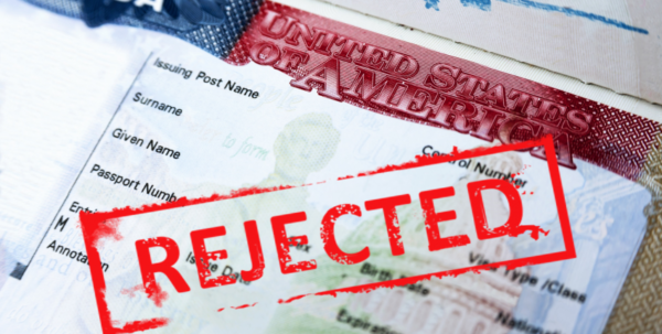 """A US visa with the words """"rejected"""" written over the top"""