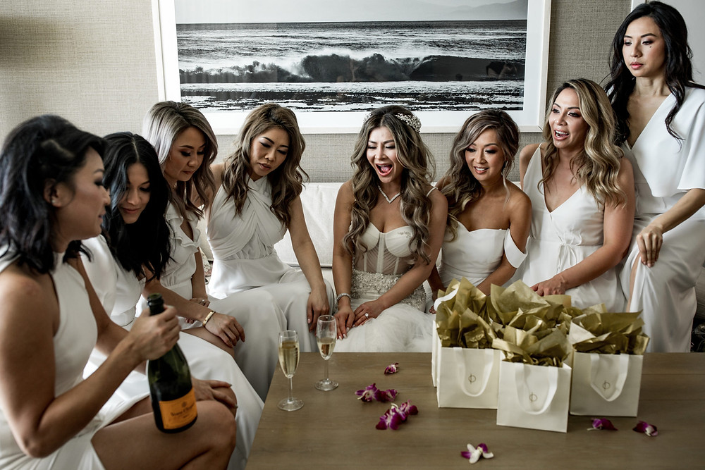 Bride gifting her bridesmaids custom jewelry on her wedding day.