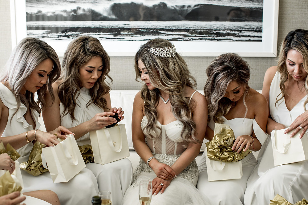 A bride gives her bridesmaids their custom IO Collective rings