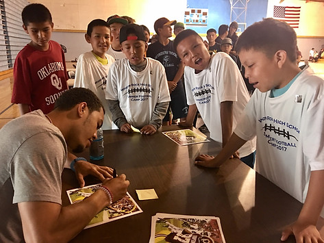 Kendal Thompson signs autographs