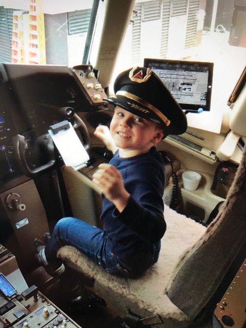 Caden in the cockpit. We got there safel