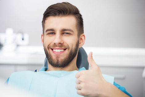Thumbs up manalapan implant dentist