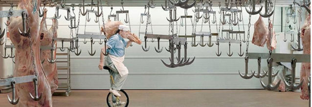 Butcher cycling dangerously  in coolroom