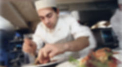 Chef Arranging Dishes