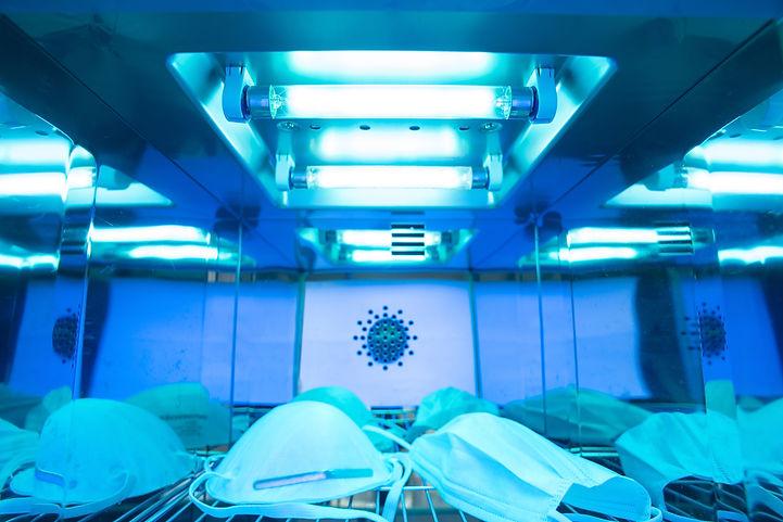 UV light sterilization of face mask to d