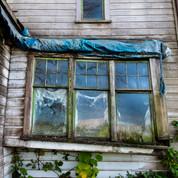 Sagging Windows On an old farmhouse near McMinville, Oregon