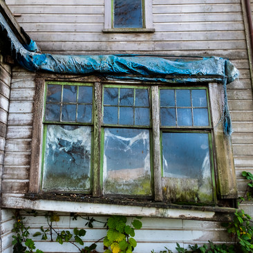 Sagging Windows On an old farmhouse near McMinville, Oregon