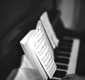 Canva - Person playing on piano_edited_e