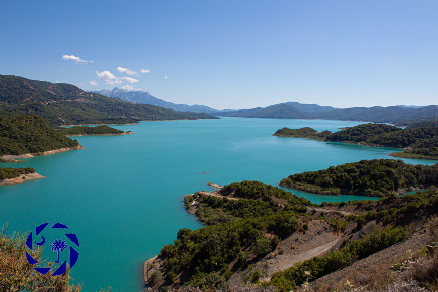 Blue water lake surrounded by mountains in the country of Greece
