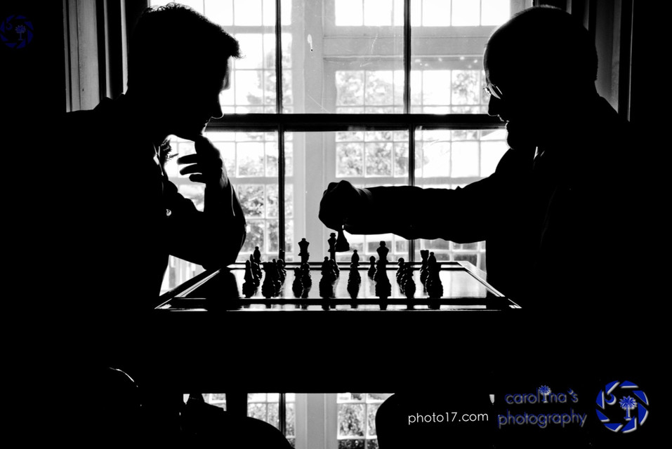 Groom Playing Chess w/ Dad