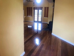 Indoor timber floor finish. Canberra painters