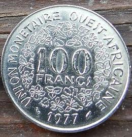 100 Франков, 1977 года, BCEAO,Монета, Монеты, 100 Francs 1977, UNION MONETAIRE OUEST-AFRICAINE, Рослинний орнамент,растительный орнамент,floral ornament на монете, Taku Symbol,Символ Такуна монете.