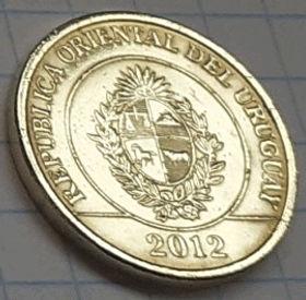 1 Песо,2012 года, Уругвай, Монета, Монеты, 1Pesos 2012, Republica Oriental Del Uruguay, Fauna, Mulita,Фауна, Мулита на монете,Coat of arms of Uruguay, Герб Уругваюна монете.