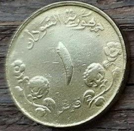 1 Гирш, 1987 года, Судан, Монета, Монеты, 1 Girsh 1987, Sudan, Рослиннийорнамент,растительный орнамент,floral ornamentна монете,Будівля,Building,Зданиена монете.